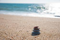 Stones stack on the sand