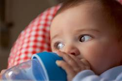 portrait of baby boy drinking from the bottle