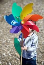 Little boy holding colored pinwheel