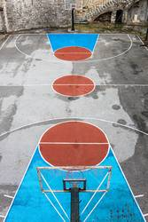 Empty and grunge basketball court. Aerial view.
