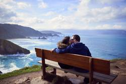 """A couple kissing in """"the best bench in the world"""""""