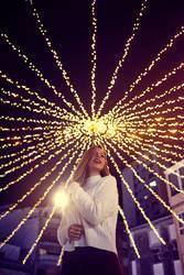 Young woman enjoying Christmas lights in Vigo