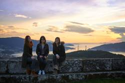 Three young woman posing at sunset