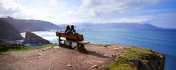 """A couple in the """"best bench in the world"""" in Galicia"""