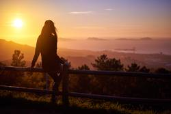 woman contemplating the sunset over three islands