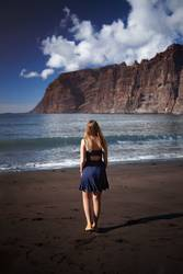 Young girl on Los Gigantes Beach, in Tenerife