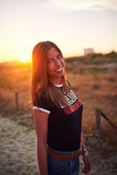 Girl smiling at sunset