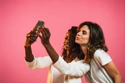 Cheerful women posing for selfie