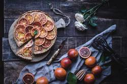 Tasty tart with red oranges