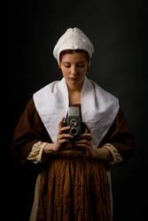 Medieval woman with photo camera