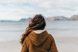 Woman posing at lake