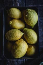 Tasty lemons on wooden table