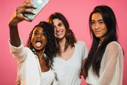 Women taking selfie in studio