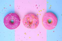 three round different sweet donuts