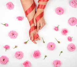 hands with smooth skin wrapped with red silk ribbon