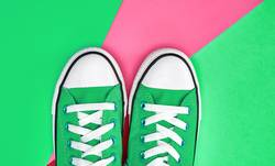 pair of green textile sneakers