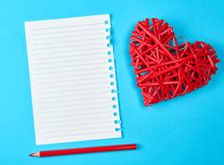 wooden wicker red heart and an empty white sheet