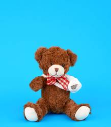 teddy bear with rewound white bandage paw