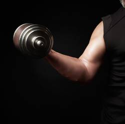 hand of a man holds a type-setting dumbbell