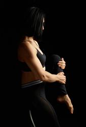 woman with black hair and a muscular body