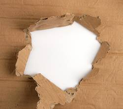 brown sheet of paper with a hole, full frame