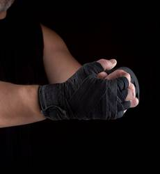 hands wrapped in black sports textile bandage