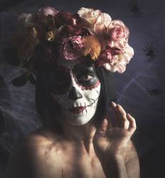 beautiful girl with traditional mexican death mask