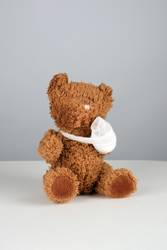 brown teddy bear with a bandaged paw