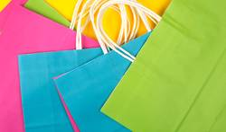 many multi-colored paper shopping bags