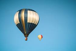 Two hot air balloons in the clear sky