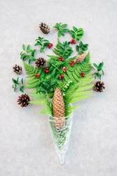 Glass cone with wild forest plants and berries