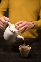 a man serve the tea