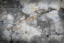 Dark textured stone surface