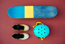 A skateboard, a pair of shoes, and a helmet