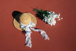 A laced hat and a bouquet of flowers