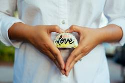 A rock with the word love written on it.