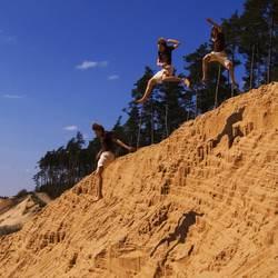 Stunt im Sand