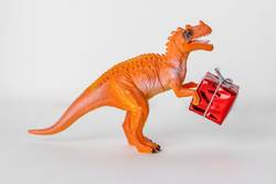 Dinosaur toy with christmas present box.