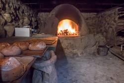 Baking bread in a historic oven.