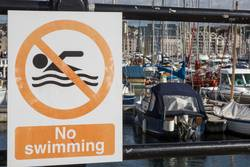 No swimming sign in a marina.
