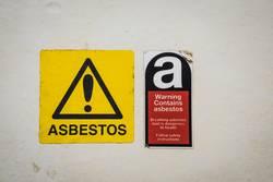 Warning Contains asbestos!