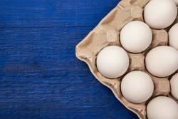 Fresh eggs as background.