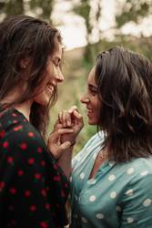 Two young women look at each other