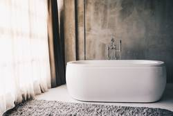 Modern luxury bathtub in the bathroom interior