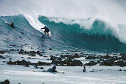 surfer takes off