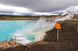 Dangerous blue hot spring in Iceland with sign