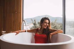 Woman in a modern bath tub