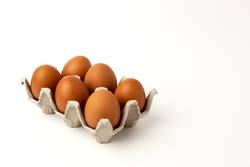 Fresh raw eggs on white background
