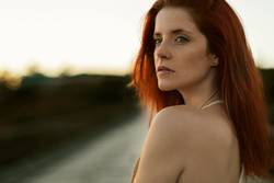 Close up portrait of redhead woman with melancholic look