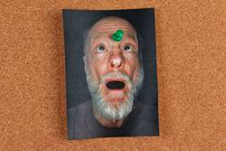 funny portrait photo pinned to message board
